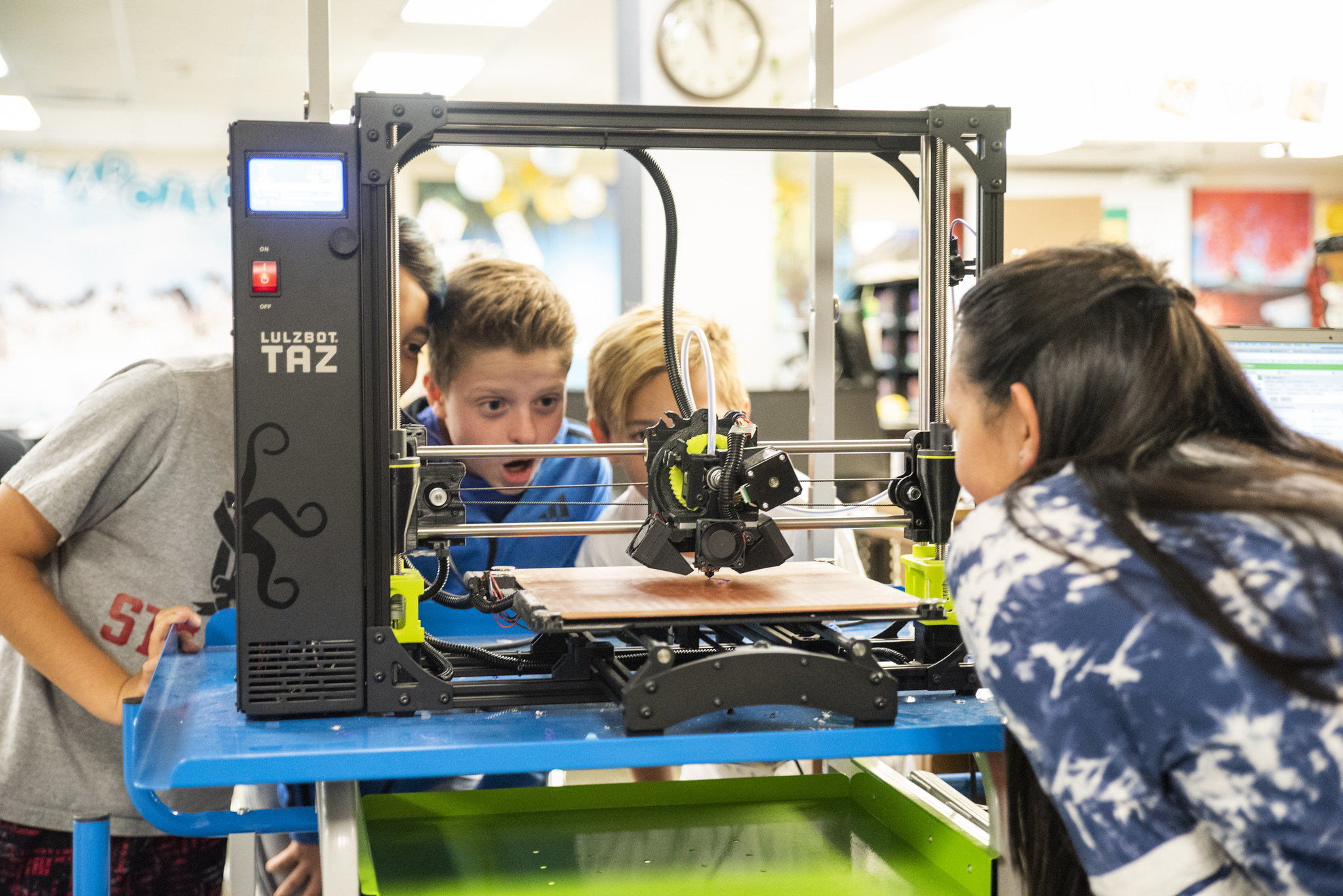 students with a 3d printer